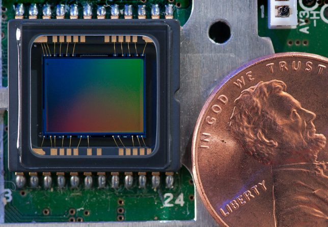 Photographed next to a penny reveals the real proportion of the Minolta's 8.8 x 6.6 mm CCD image sensor.
