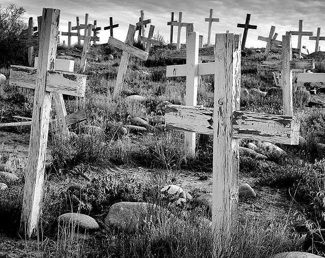 "Made with my Minolta DiMage 7i in black-and-white mode on a cold November morning, this image of a southwestern mission graveyard in northwest New Mexico was made possible by ""The Zone."""