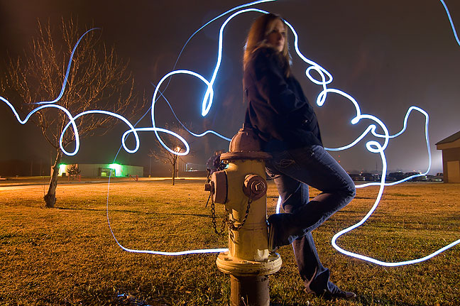 Julie, who missed last week's class, models for a light-painting experiment