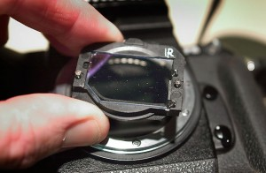 Removing the infrared filter on my DCS-720x for cleaning; this camera does not have an anti-aliasing filter.