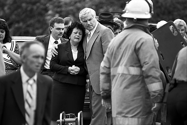 "Previously unpublished image of the catastrophic ""Funeral Crash"" of May 1992, when four members of a family driving to a funeral were killed when struck head-on by a pickup truck; I used my 300mm and kept my distance to shoot images like this one that day"