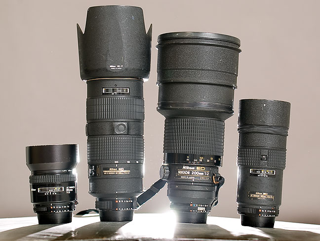85mm f/1.8, 80-200mm f/2.8, 200mm f/2.0, and 180mm f/2.8 Nikkor lenses.