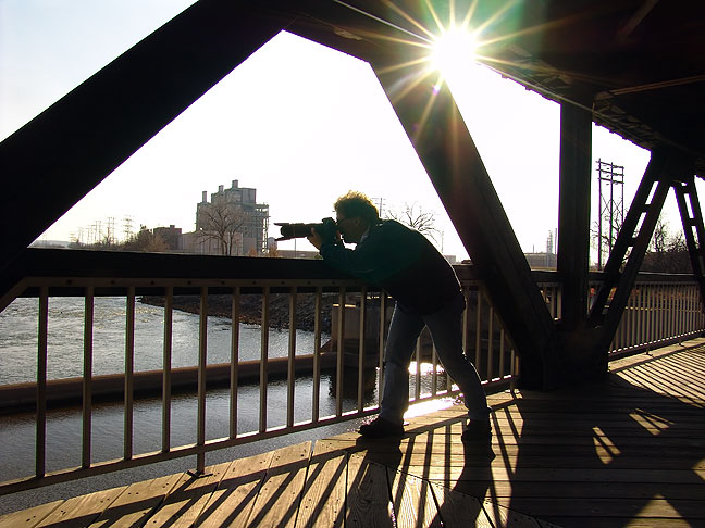 In the Zone: Robert makes pictures on Tulsa's walkover bridge along Riverside drive.