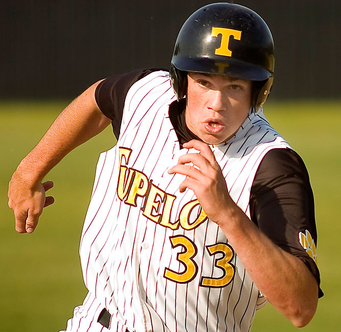 A Tupelo base runner charges for third base in this image from the spring 2011 high school baseball season. The intensity on his face is expressed by this image in a way no other method can.