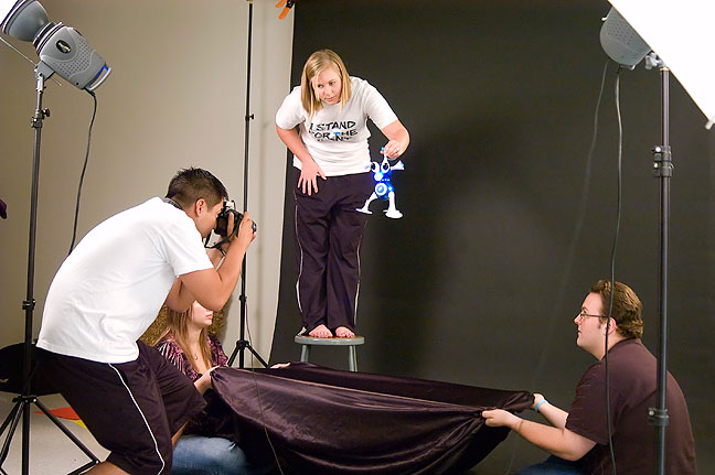 "Kelly, Chesna and Robbie work together in an effort to photograph the ""Nerd"" toy in the studio Wednesday."