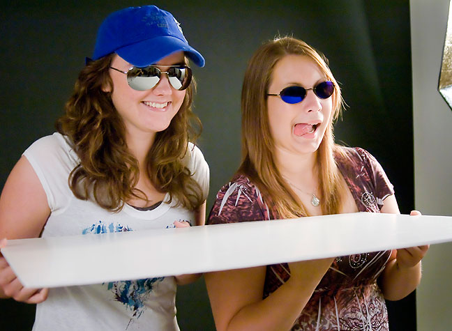 Taylor and Erin share a laugh as they model sunglasses in this morning's session at ECU.