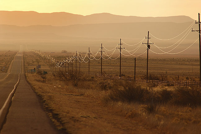 Power lines and U. S. 380, New Mexico, April 2006. I made this image one early morning driving from Socorro, New Mexico to see the Trinity Site, where the first atomic bomb was tested. Leading lines, hypnotic light, and the vast desert put this image in the top five.