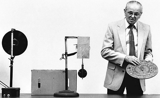 Clockmaker Noisy Quiett shows his craft to school children, 1989