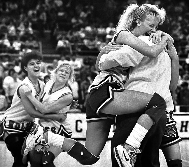 The Vanoss Lady Wolves celebrate winning the state basketball championship, 1992