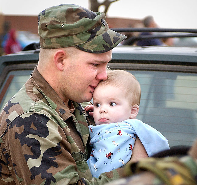 A soldier says goodbye to his child, 2006