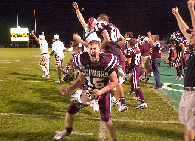 Ada Cougar football players celebrate a victory in the last seconds of a game, 2009