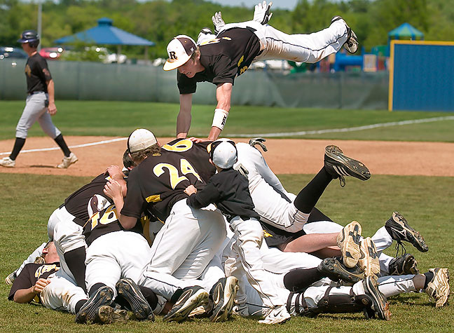 The Roff Tigers pile on at the mound after winning a third consecutive state championship, 2010