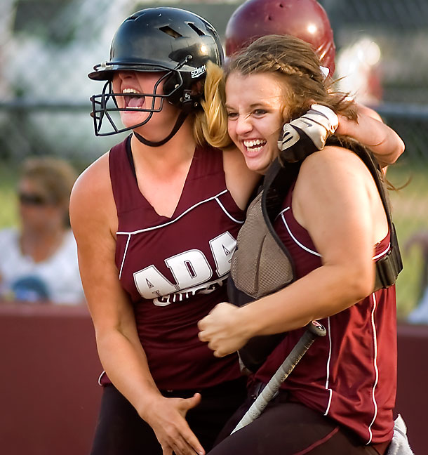 Ada Lady Cougars sotfballers celebrate an extra-inning home run, 2010