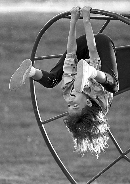 A girl plays in a Shawnee park, 1988
