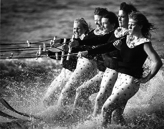 Water skiers race past the crowd at the annual Riverfront Festival, 1988