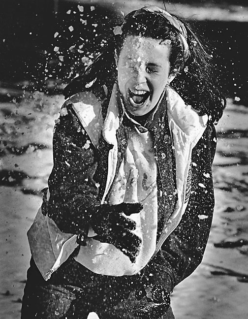 A student takes a hit in a snowball fight, 1985