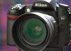 This is Nikon's 35mm f/1.8 lens mounted on one of my D80s. As you can see, it is compact, and I can attest that it is also very lightweight.