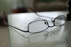 Shallow depth of field can isolate a subject very effectively, like with this pair of reading glasses in our living room.