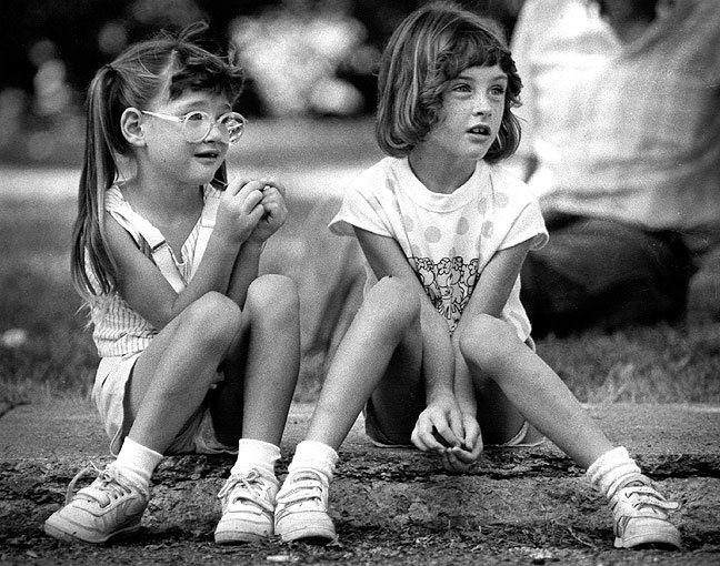 I photographed these two girls at a street festival in Streator, Illinois, in 1988 with one of my favorite lenses of the era, the Nikkor 180mm f/2.8 ED. In recent years I have replaced that lens with the excellent AF-Nikkor 180mm f/2.8 ED.