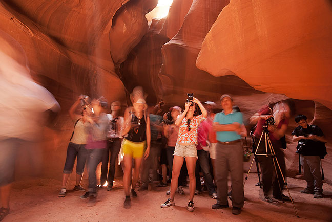 Photographers and tourists cluster together to make pictures in Arizona's Antelope Canyon in May, 2012.