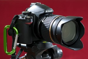 This is Abby's Nikon D3000. Note that she keeps a green aluminum carabiner on the right camera strap.  When she's hiking, she locks it though her belt loop, so it doesn't fall forward when she leans or climbs.