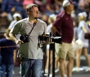 My editor, Dan, uses two digital SLR cameras to photograph a football game recently. The camera in his left hand is his new Nikon D3200, which he used to make video of the game for our newspaper's web site.