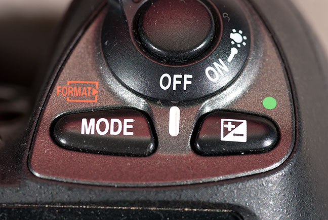 "Nikon's professional-level cameras control exposure mode by pushing the ""mode"" button and turning the command dial, selection P, A, S, or M, and resulting in an exposure mode than can't be accidentally changed. Next to it is exposure compensation (+ and -) which is one of the controls I use most often in my daily shooting."