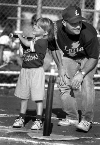 "A member of the ""Latta Kittens"" t-ball team gets hitting advice from a coach in this June 1996 image. It's a nice moment, and doesn't deserve to be forgotten."