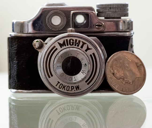 The Toko P. W. Mighty camera poses with a dime for scale.