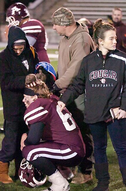 Marcy, Tyler and Taryn comfort Tanner after the Ada Cougars loss to Weatherford in the first round of the playoffs last night at ECU's Norris Field.