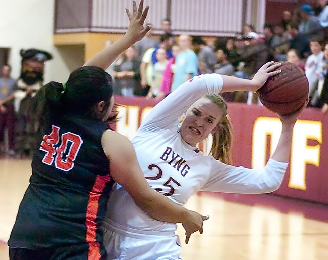 A Byng Lady Pirate is fouled during tournament play last week at Bill Koller Field House. The lighting there isn't great, so I often opt to shoot with my 50mm f/1.8 at f/2.0. The horizontal composition captured this moment of conflict well.
