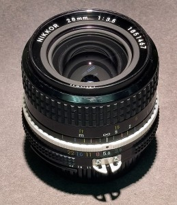 "I bought this Nikkor 28mm f/3.5 used in the mid 1990s. It is an ""AI"" lens, which dates it as pre-1981 or so. I think I paid $75 for it. It was lightweight and amazingly sharp."
