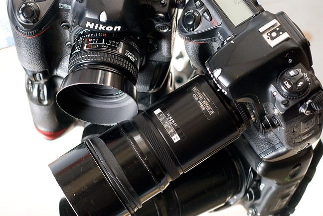 The 180mm plus the 28mm are a good team for basketball and similar sports action and features.