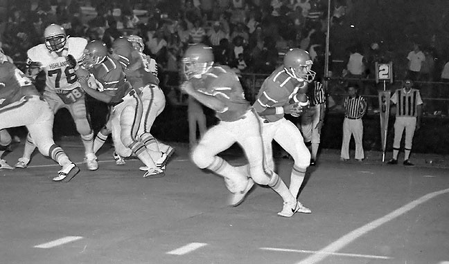 Imagine how difficult it must be to capture peak action at a football game if you take this picture (September 1980), then wait eight seconds for your flash to cycle before you can take another.