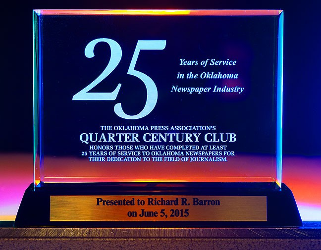 Quarter Century Club award; for the photographically interested, I shot this award using three colored lights angled to pick up the frosted lettering in the back of the glass.