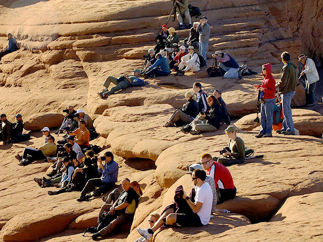 Throngs of tourists gather at Delicate Arch in October 2009. With this many people on hand to share the experience, it's important to remember that we all share this wonderful place.