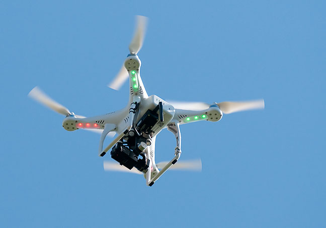 "An unmanned aerial vehicle, or ""drone"", hovers above an event I covered recently."