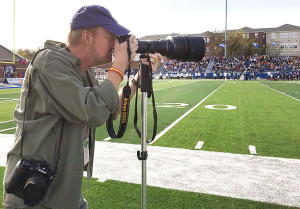I dusted off my wonderful 1985-era 400mm f/3.5 Nikkor ED-IF supertelephoto lens yesterday cover a college football game in Durant. I wanted a picture of me using it, so I handed my phone to my friend Meredith and asked her to shoot this. It was the one way I could be certain I would have the image.