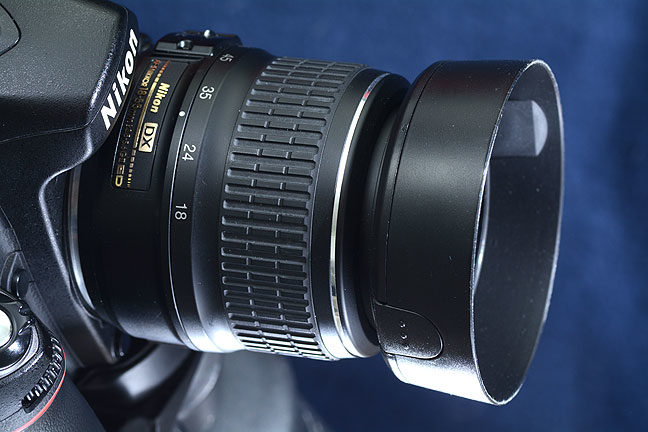 "This is the most common lens in photography today, the so-called ""kit lens."" This is Nikon's Nikkor AF-S 18-55mm f/3.5-5.6, but every camera maker has one. If I have to shoot at f/4 or f/5.6 to get sharp results with my Sigma 17-50mm, why don't I just use a kit lens at a quarter of the price and half the weight?"