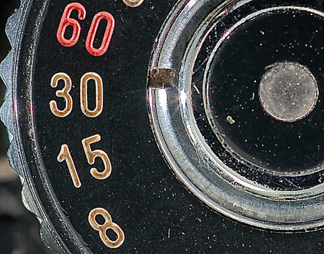 ...the same shot of a shutter speed dial with way too much unsharp mask.