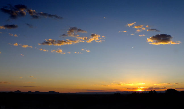 This is the wide view of a beautiful New Mexico sunset. Compare it to the next frame, made with the same camera just a second or two later...