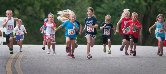 Kids scamper down Scenic Street in Ada's Wintersmith Park during the kid's race at the annual Fireball Classic 10k/5k run.