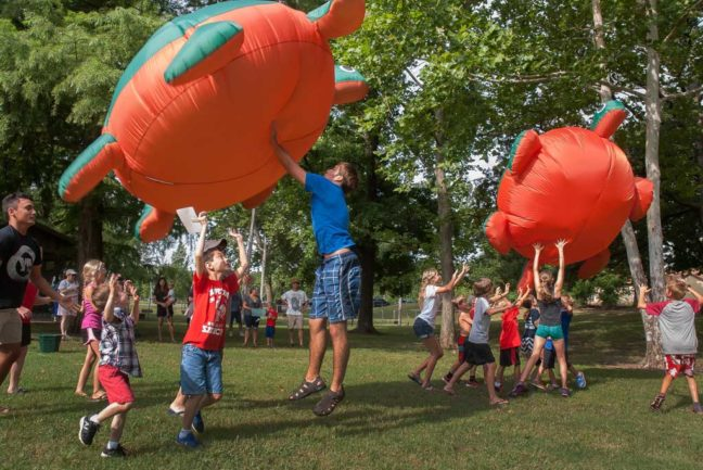 "Children participate in ""giant"" turtle race during the kid's games at the Independence Day 2016 celebration in Wintersmith Park Monday July 4."