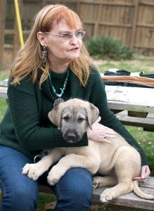 Abby holds her new puppy at the farm where she bought him. The road trip, to Rolla, Missouri, as always, was an opportunity to make pictures.