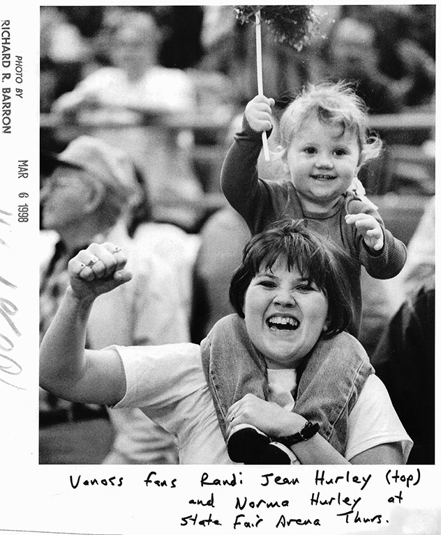 Vanoss fans Norman Hurley and Randi Jean Hurley cheer for the Wolves during state championship action at the Oklahoma State Fair Arena in Oklahoma City March 6, 1998.