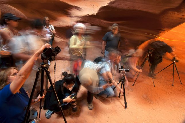 A passel of photographers photographs Antelope Canyon in May 2012.