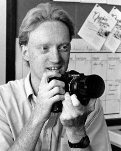 "This is my official ""candid"" self-portrait for the colophon of the 1985 Sooner Yearbook. I am holding a Nikon FM2 with my 105mm f/2.5."