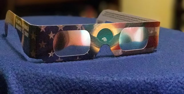 Disposable paper eclipse glasses like these are available in ten packs on sites like eBay and Amazon.