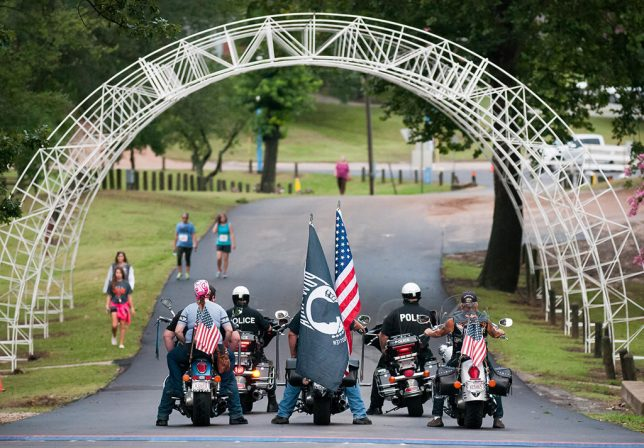 Motorcyclists and police officers line up to escort runners in the 50th Annual Fireball Classic half-marathon, 10k , and 5k race Tuesday morning, July 4, 2017 in Wintersmith Park. This image was on the front page of the July 6 Ada News.