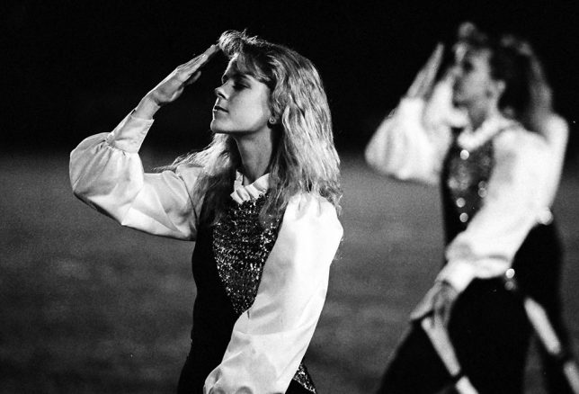 "This is an Ada High Color Guard member I photographed in 1989 whose name is think is Cheri Platt. I had a huge crush on her, since I was single and 26 at the time. Ask yourself: is this memory diminished or ruined in any way by being a ""low resolution"" film image?"